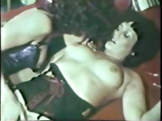 hot vintage lesbo act giving a kiss and using