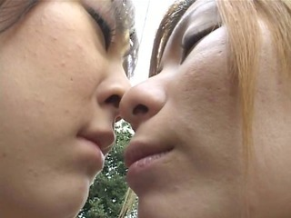 lesbian babes giving a kiss in public