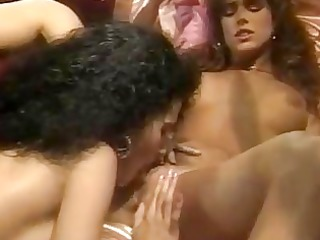 two unshaved darksome haired lesbians licking